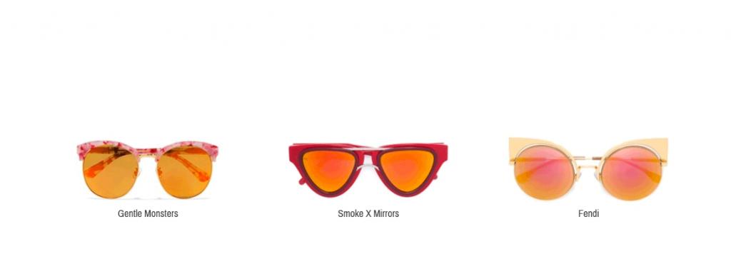 Hier sieht man orangene Sonnenbrillen von Gentle Monsters, Smoke X Mirrors und Fendi.